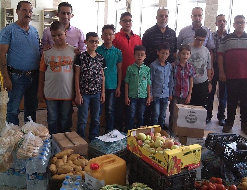 تبرع قوات الأمن الوقائي الفلسطيني بمواد غذائية لصالح الطلاب المكفوفين في جمعية أصدقاء الكفيف